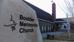 A sign of Boulder Mennonite Church and photograph of building.